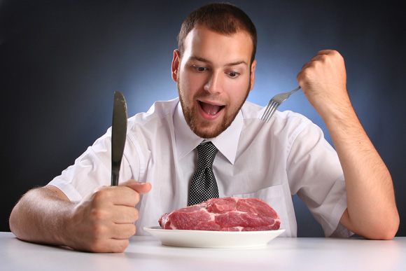 young man eating raw meat